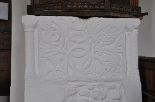 Carving on the unusually deep ancient stone font