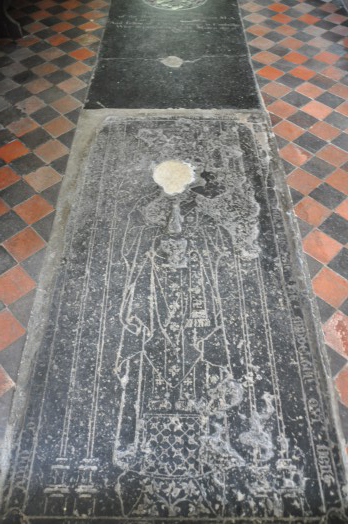Carved slab at Middleton Church dedicated to 'Sire James Samson' Rector of the Parish who died in 1349