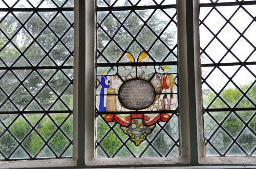 An unusually contemporary stained glass window in memorial to members of a local farming family