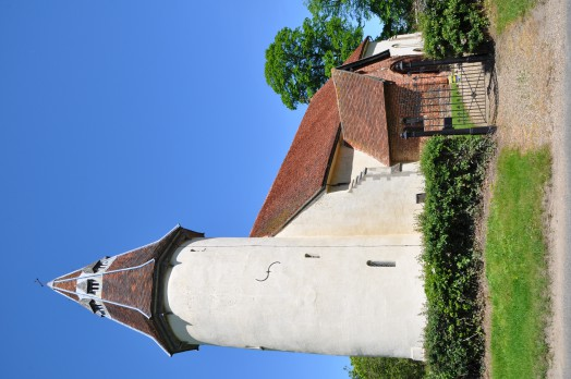 The distinctive round tower of Lamarsh church viewed from the road
