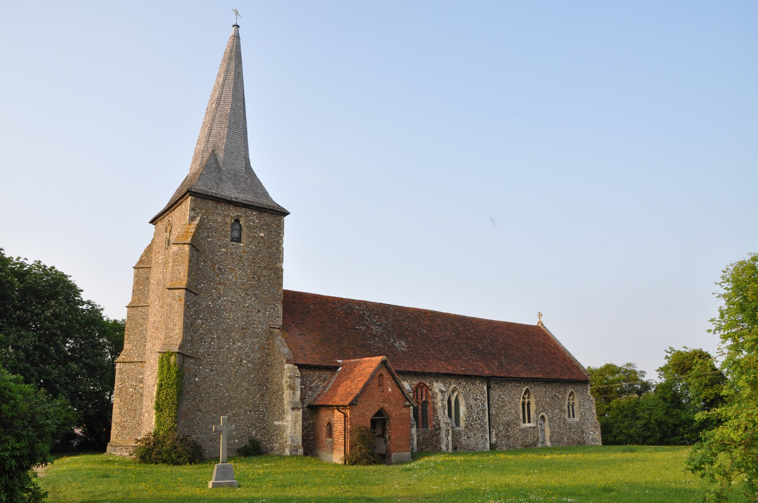 The distinctive twisted spire of the church at Great Henny